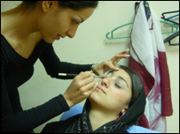 Nariman al-Rostamani, TV presenter, has her make-up done