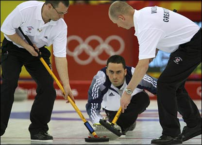 GB curling team against Sweden