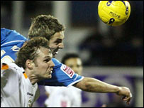 Luton Town's Markus Heikkinen (front) and Reading's Kevin Doyle battle for the ball