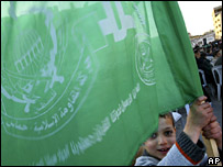 A Palestinian boy waving a flag at a pro-Hamas rally in Gaza City