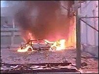 Car burning outside Benghazi Italian consulate