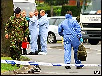 A bomb disposal van and forensic teams in Small Heath