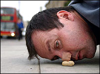Mark McGowan pushing monkey nut with his nose