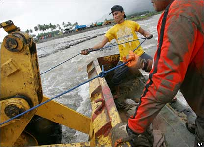 Machinery used to ferry a child victim to a waiting ambulance after being dug out from the mud  - 18/2/06