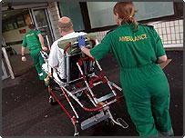 Paramedics take a patient to A&E
