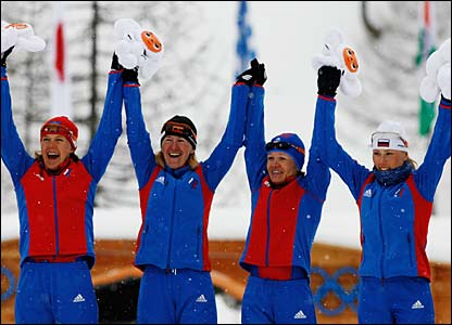 Russia's Eugenia Medvedeva-Abruzova, Julija Tchepalova, Natalia Baranova-Masolkina and Larisa Kurkina celebrate gold in the women's 4 x 5km relay