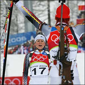 Germany's Kati Wilhelm and Martina Glagow celebrate gold and silver in the women's 10km biathlon