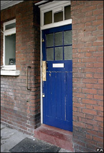 Door to flat raided by police