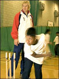 Matthew Hoggard coaches a young bowler in Bethnal Green