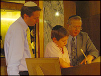 David Gould, left, with son Ben and Rabbi Silverman