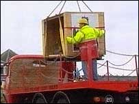Clock crate being winched onto a trailer