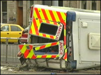 The ambulance crew suffered minor injuries in the crash