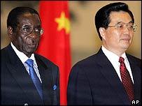 Zimbabwean President Robert Mugabe, left, and Chinese President Hu Jintao