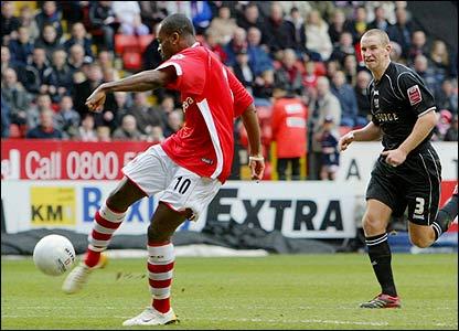 Darren Bent wrong-foots Andy Frampton to score