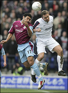 West Ham's Hayden Mullins and Kevin Davies of Bolton vie for the ball