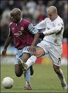 West Ham's Nigel Reo-Coker fends off Bolton's Stelios Giannakopoulos