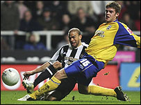 Newcastle match-winner Kieron Dyer gets in a first-half shot