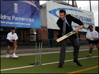 Michael Vaughan plays cricket with young players in Southall