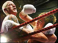 Alex Arthur (right) lands a right to Ricky Burns