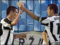Halenar (left) celebrates his first goal