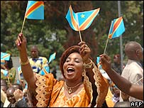 Woman celebrates with the new DR Congo flag