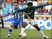 Pedro Munitis (l) tangles with Newcastle's Celestine Babayaro