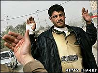 Iraqi being stopped by a US Marine