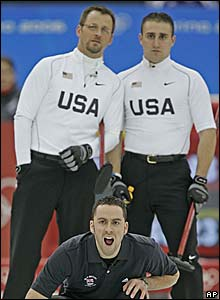 GB skip David Murdoch is overlooked by Shawn Rojeski and Joe Polo of the US curling team