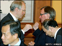 U.S. Assistant Secretary of State for East Asian and Pacific Affairs Christopher Hill (L) with other delegates, July 28, 2005 in Beijing, China.