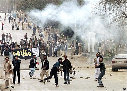 Protesters throwing stones at police and military in Islamabad