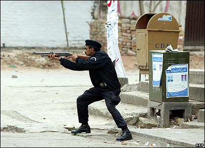 Policeman fires at crowd