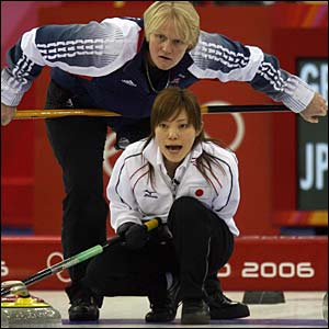 GB women's curling skip Rhona Martin looks on anxiously above Japan's skip Ayumi Onodera