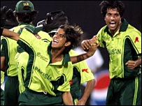 Pakistan celebrate victory (photo copyright ICC)