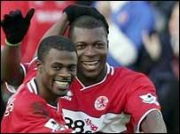 Yakubu (right) celebrates scoring with George Boateng