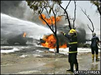 Iraqi firefighters try to extinguish a tanker fire after an explosion near Baghdad