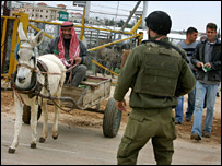 Palestinians at an Israeli checkpoint in Hableh, West Bank