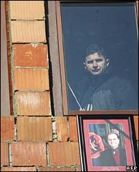 A Kosovo Albanian watches the funeral procession of President Ibrahim Rugova in Pristina