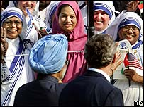 President Bush and Indian Prime Minister Manmohan Singh are greeted by Carmelite nuns