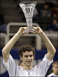 Andy Murray holds the trophy aloft after his win over Lleyton Hewitt