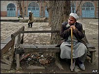 A man sits on a bench in Kabul, Afghanistan