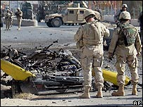 US soldiers at the scene of a suicide bombing in Kandahar, Afghanistan