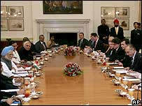 French President Jacques Chirac, fourth right, and Indian Prime Minister Manmohan Singh, third left, attend a meeting with ministers and officials at Hyderabad House in Delhi