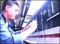 A trainspotter films the retiring train
