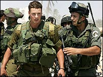 Cpl Avi Bieber led away after refusing to remove Jewish settlers in Gaza Strip, 26 June 2005