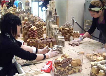 Artists building a city made of biscuits