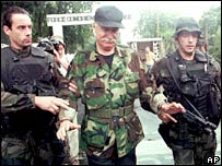 Bob Denard (centre) surrenders to French troops in Moroni, the Comoros Islands, in 1995