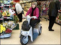 Karen Turner on her scooter in a supermarket