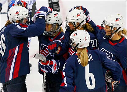 The USA's women's ice hockey team celebrate a goal against Finland
