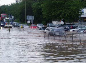 Car struggle to get through flood water