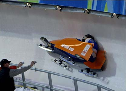 The Netherlands' Ilse Broders and brakewoman Jeannette Pennings crash in the women's bobsleigh competition